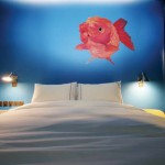 boutique hotel bedrooms interiors,maritime wall decor,red fish bedroom wall art,hotel design ideas,white modern bedding,
