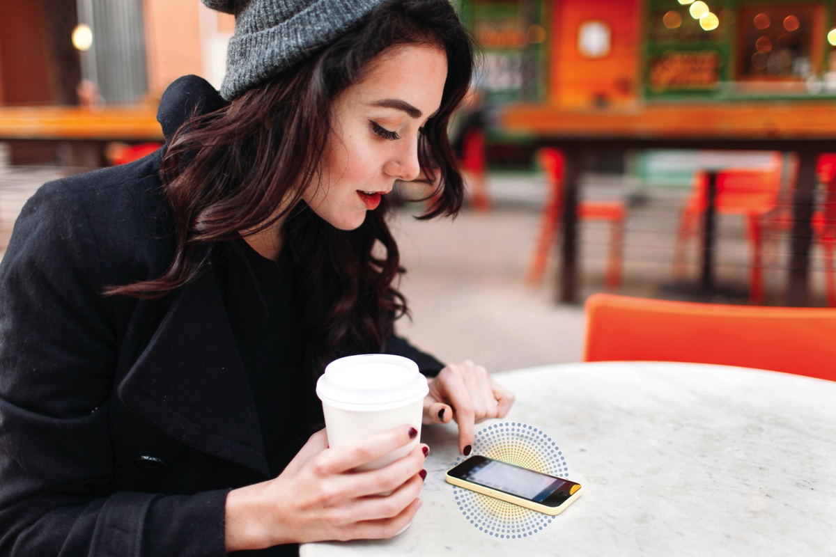 corian charging surface,corian surface charger,innovative smartphone charging surface,new materials design technology,girl texting on phone,