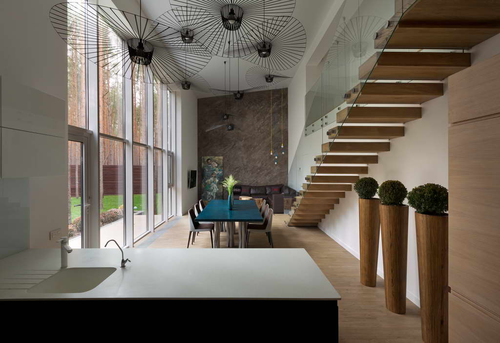 contemporary dining room design,designer ceiling lights,wood and glass staircase,house with a view,modern kitchen ideas,