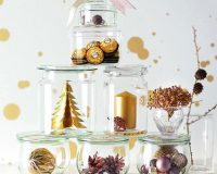 glass Christmas tree ideas decoration,Christmas table decoration ideas with candles,white silver and gold Christmas decorations,holiday table centrepieces,ferrero rocher decoration ideas,