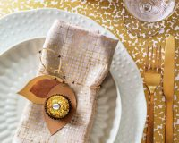 white and gold Christmas table decorations,metallic holiday table ideas,wine glasses with gold design,ferrero rocher wedding table decorations,gold plated cutlery ideas,