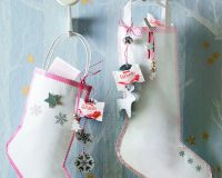 how to decorate gifts for Christmas,handmade boots holiday decorations,raffaello decoration holidays,red and white paper boots wall design,silver and gold stars decor ideas,