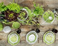 green and white table decorations,artichoke shaped bowl,dining table setting ideas in green,artichoke shaped tableware,table setting ideas for everyday,