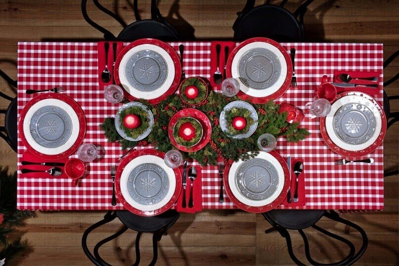traditional table setting ideas,natural holiday decorating ideas,red and white checkered tablecloth,gray plates with snowflakes,table centerpieces made of branches,