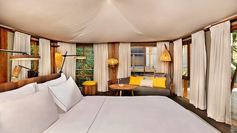 white and yellow bedroom decor,wooden bed ideas,latin american bedroom,kasiiya papagayo luxury eco retreat,natural materials bedroom,