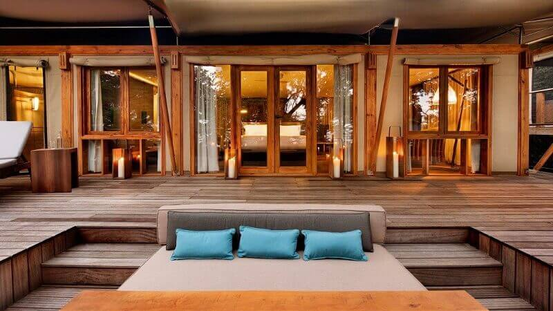 blue cushions for outdoor furniture,terrace design ideas,wooden lodge costa rica,top eco lodges in the world,resort designs,