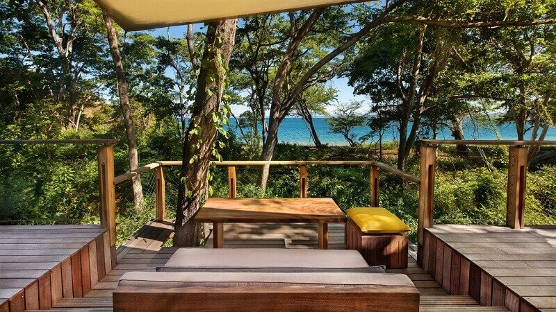 eco lodge terrace hotel,wooden resort terrace design,best resorts in the world,natural materials architecture,travel ideas,
