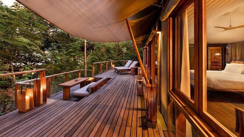 best resorts in the world,wooden hotel terrace,wooden outdoor lighting fixtures,natural awning ideas,costa rica resorts eco,
