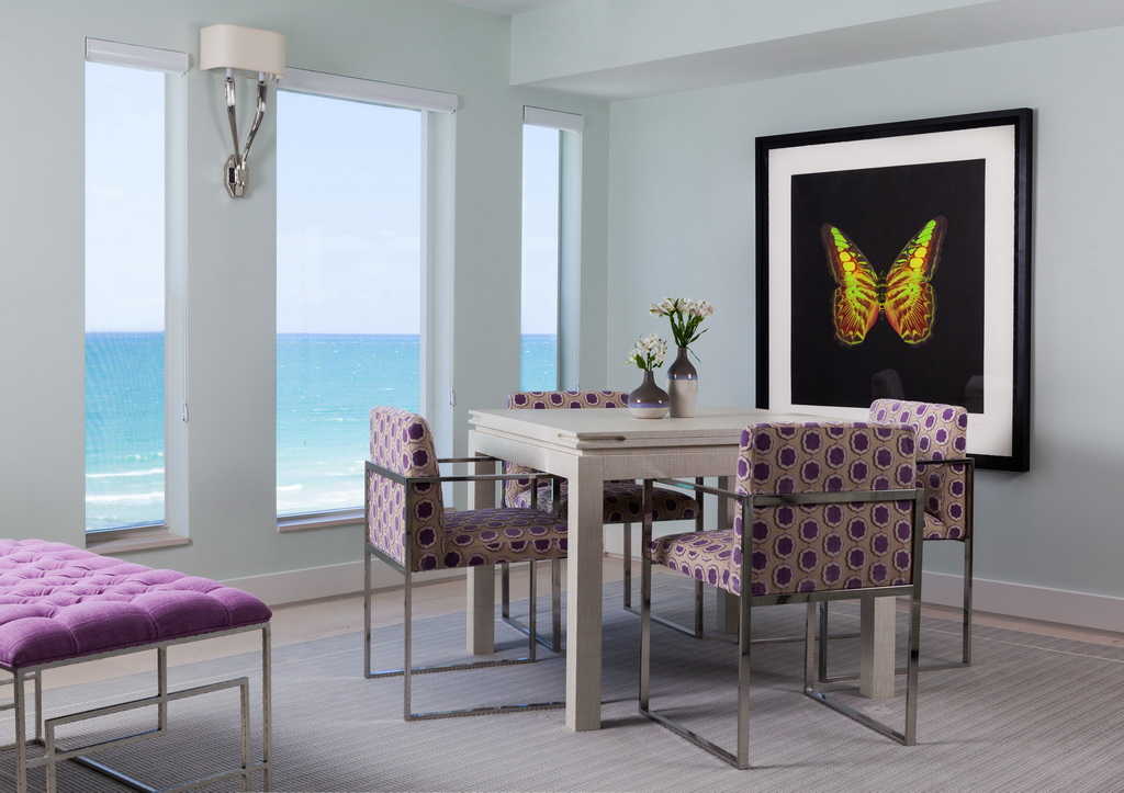 dining room with a sea view,lavender color decor,white dining room table,lilac dining chairs,butterfly art ideas,