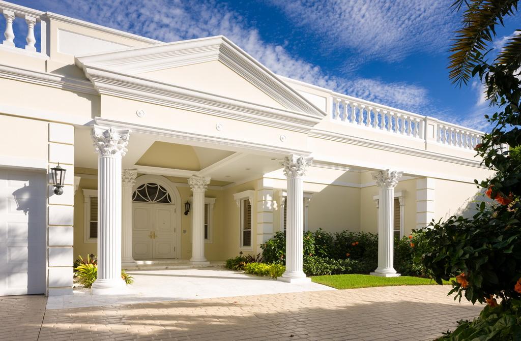 Classic palm beach regency villa timeless elegance for Classic villa exterior design