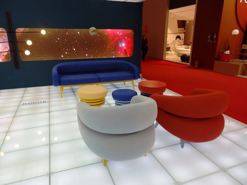 space themed interior design,red designer fabric sofa,blue designer sofa,sofas in primary colors,new design trends for home,
