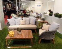 danica maricic interior designer,outdoor furniture design trends,grey and beige outdoor cushions,square wood coffee table with metal,trade fair in milan italy,