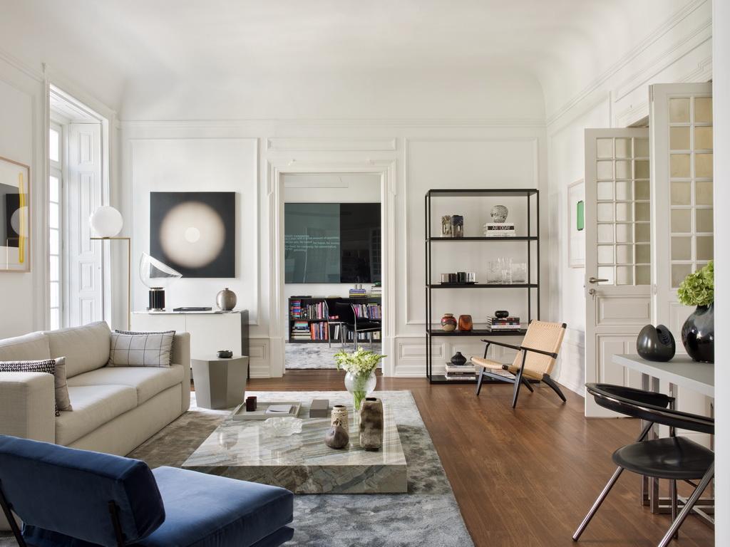 interior design showroom,renowned interior designers,luxury living room,stone coffee table,modern living room furniture,