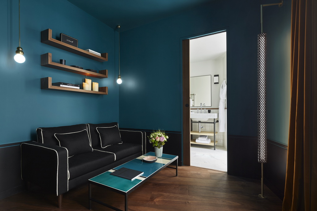 hotel green walls,black sofa in green living room ideas,le roch hotel and spa paris a member of design hotels,trendy hotel rooms,green and black room design,