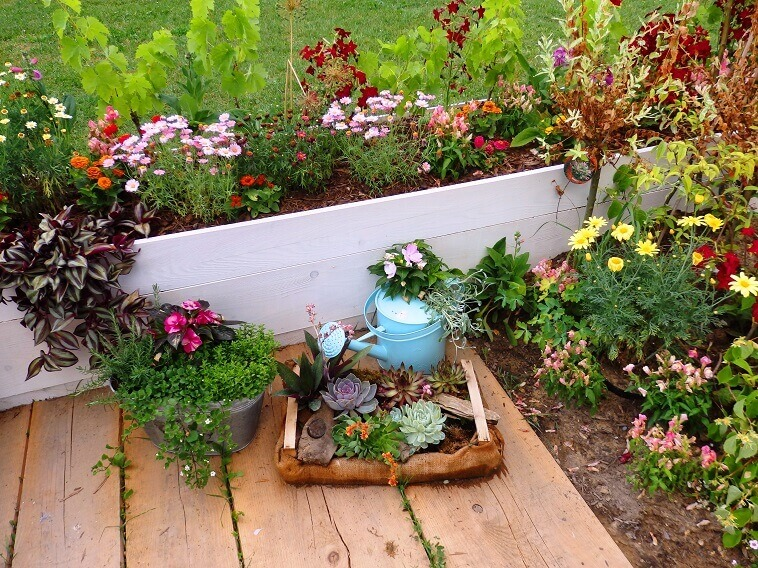 garden around a country house ideas,floraart garden croatia,rustic garden design ideas,country cottage garden ideas,colorful flowers mix in planters,