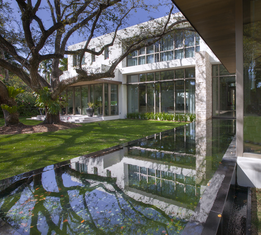 tree in a beautiful garden,modernist architecture stone,geometric house design,contemporary garden design ideas photos,large glass windows for homes,