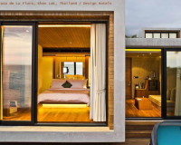 casa de la flora khao lak thailand,simple bedroom ideas,bedroom with large windows,design hotels in thailand,hotel with bedroom and living room,