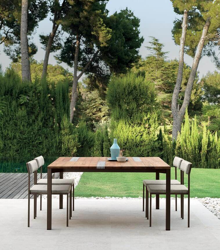 luxury outdoor dining table and chairs,teak and stainless steel outdoor furniture,how to design an outdoor dining area,talenti casilda collection,ramon esteve estudio,