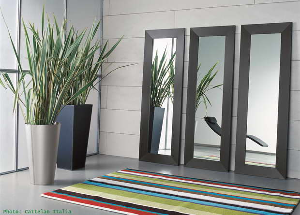 three mirrors on a wall,designer plants in pots,colorful striped carpet,colorful interior design ideas,high end lobby furniture,