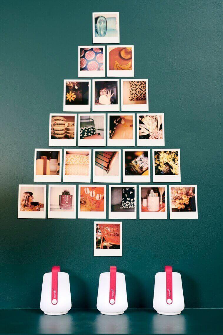 photos as holiday decoration,Christmas tree design on wall,Christmas tree made of polaroids,photos as wall art,holiday decorating family room,