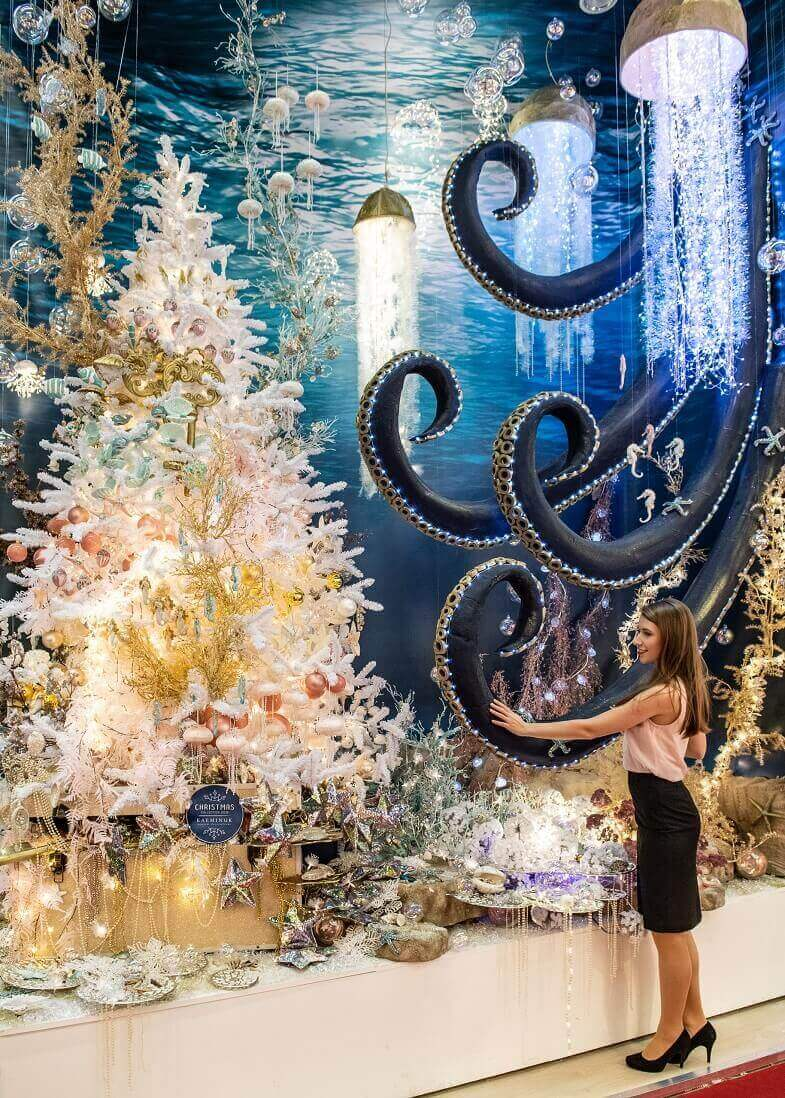 seaside themed Christmas decorations,maritime Christmas ornaments,fish and octopus holiday decorations,how to decorate shop for Christmas,retail decorating trends,