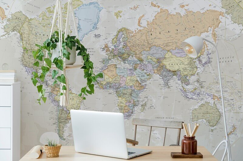 world map for home office,travel inspired home office,greenery home office interior design,indoor plants home office,world map mural for wall,