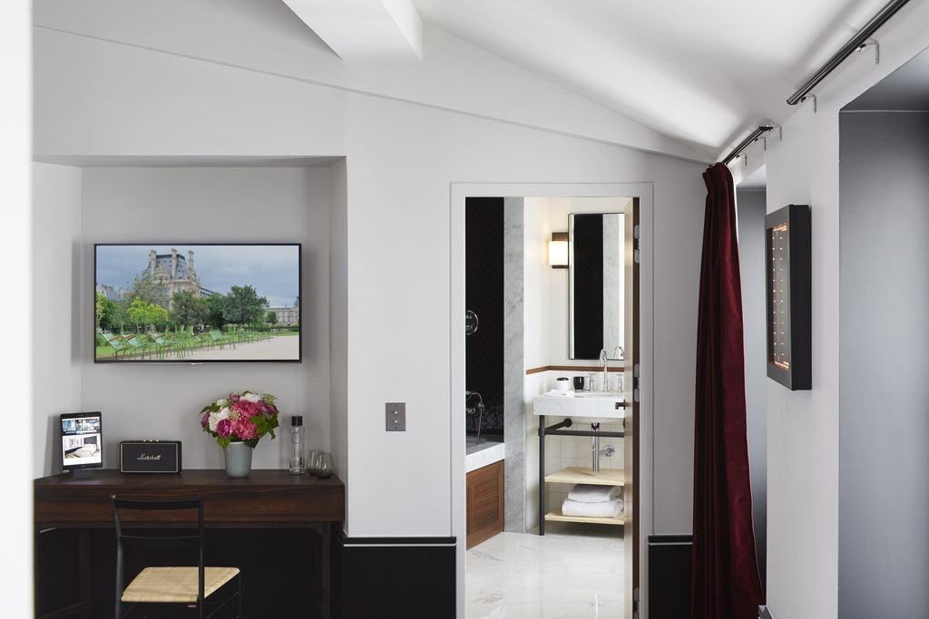 luxury hotels in paris,writing desk in hotel room,white and black hotel walls bedroom,red velvet curtains decoration,le roch hotel paris,