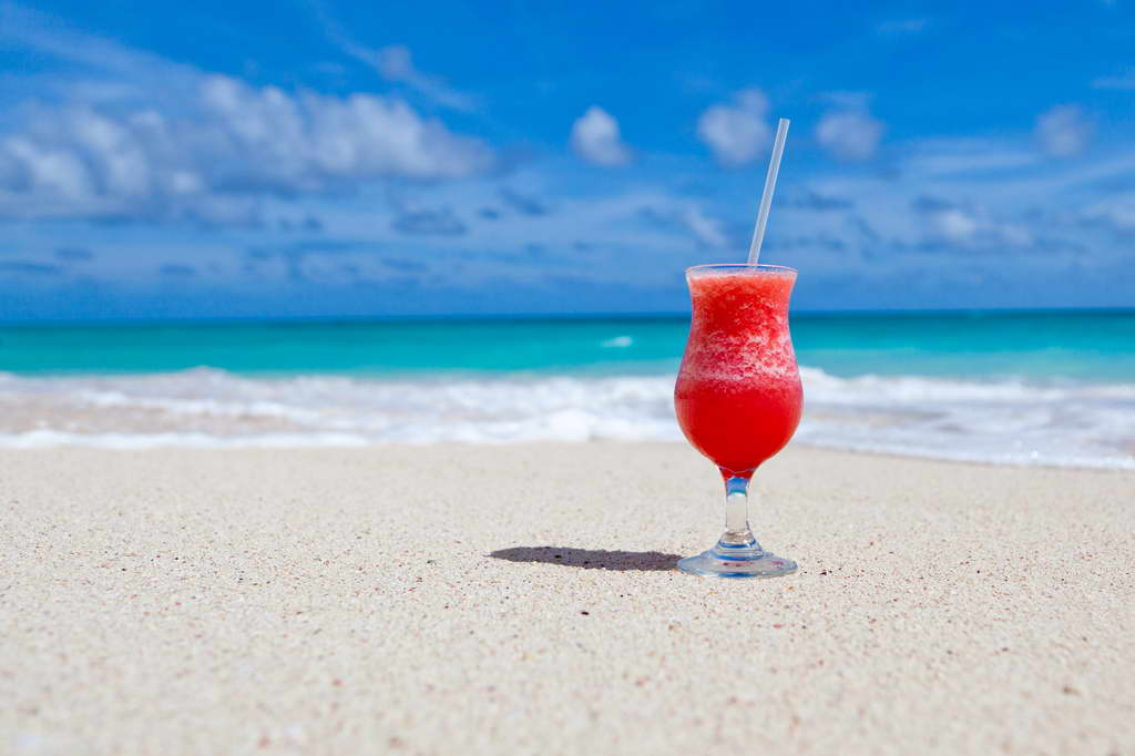 blue sky,sea,drink on sandy beach,colorful cocktail,red cocktail,colorful drink,drink ideas,summer,summer ideas,relaxing summer ideas,sandy beach,sandy beach holiday,summer on the beach,seaview,