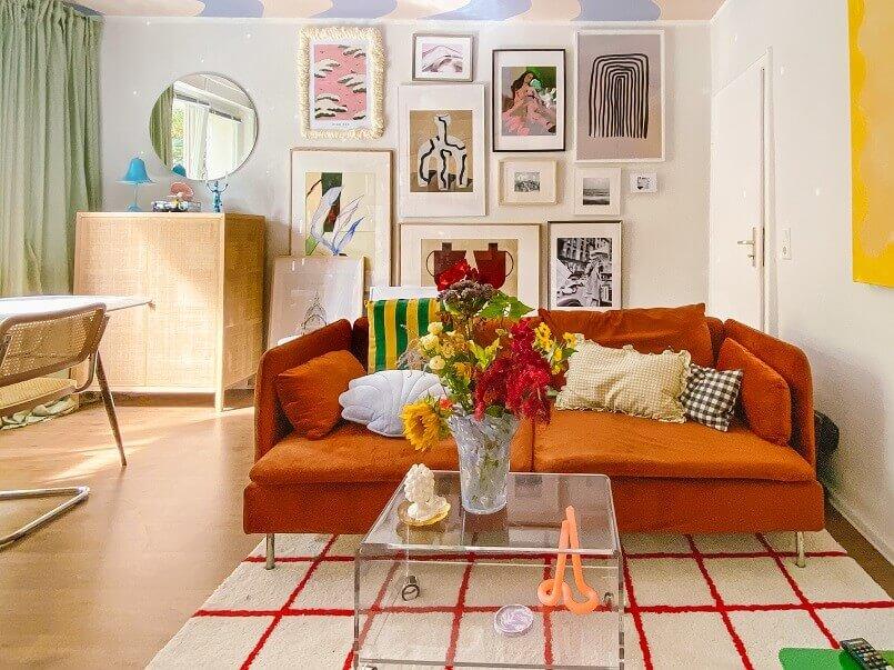 artistic living room designs,colorful living room design ideas,orange seating furniture living room,design trends 2022 home,decorating trends for living rooms,