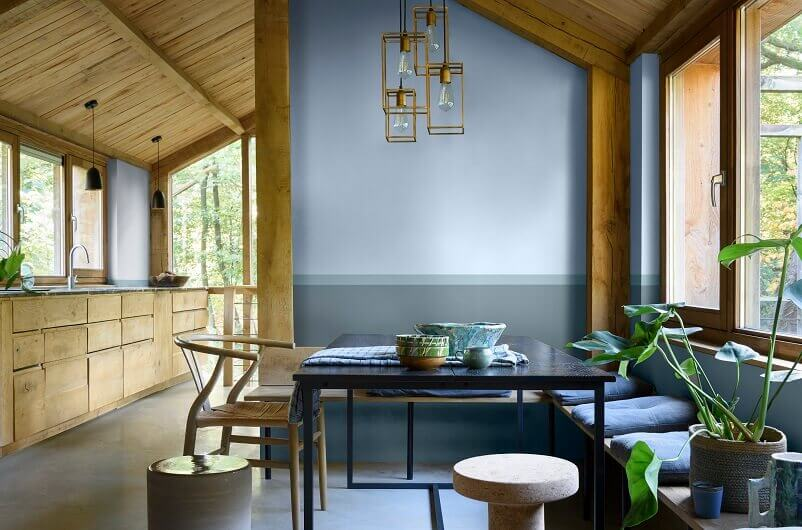 dulux colour of the year 2022,dining room with light blue walls,sky blue and wood dining room,rustic wooden kitchen cabinets,dining room with a view,