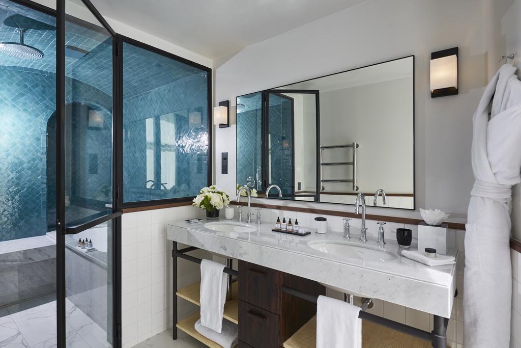 white and green hotel bathroom ideas,hotel bathroom design photos,modern hammam bathroom,le roch hotel paris,luxury hotels in paris,