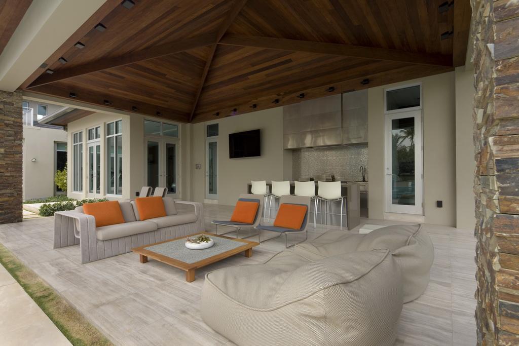 high end outdoor furniture florida,luxury terrace house design,orange outdoor cushions,garden bean bag chair,terrace design ideas,