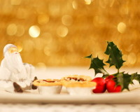 Christmas holiday table centerpieces,golden holiday decoration ideas,gold white red holiday decor,festive golden ornament ideas,white red green gold table decorations,