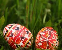 Easter egg arts and crafts,red and white Easter eggs,artistic Easter eggs,two Easter eggs on grass images,Easter decorating ideas for outside,