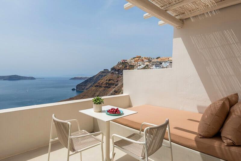 romantic travel destinations europe,terrace with sea view,enigma suites santorini greece,hotel room terrace design,romantic holidays for couples,