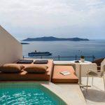 terrace with sea view,enigma suites santorini greece,hotel room terrace design,romantic holidays for couples,romantic travel destinations europe,