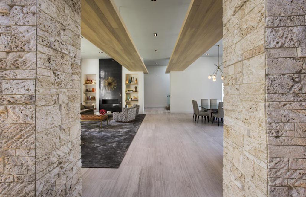 stone walls in living room,modern living room with view,contemporary architecture florida,luxury dining room ideas,high end interior design,