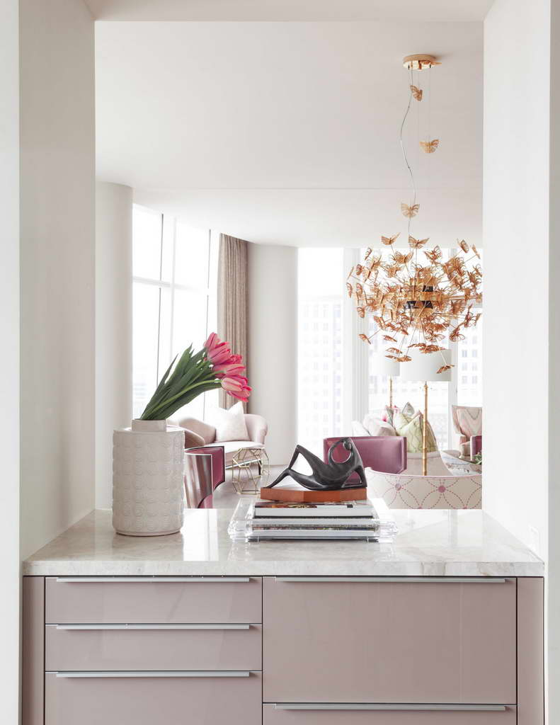 pink tulips living room,butterfly decor ideas,feminine living room design,light and bright living rooms,luxury chandelier lighting,