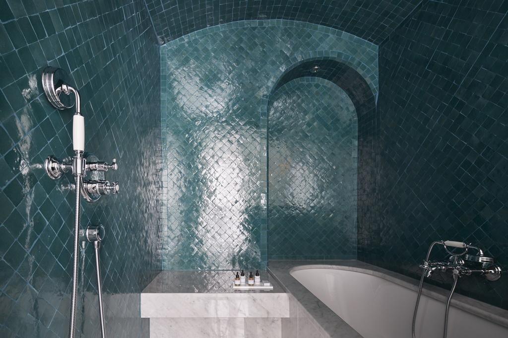 modern hammam bathroom,green ceramic tiles bathroom,white and green hotel bathroom ideas,hotel bathroom design photos,bathtub in hammam bathroom,