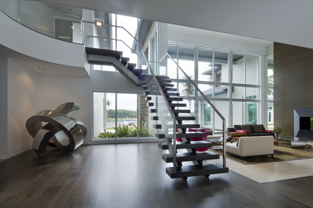 luxury staircase design,staircase design with wood and glass,sculptures in large living rooms,luxury living room with a view,high ceilings home design,