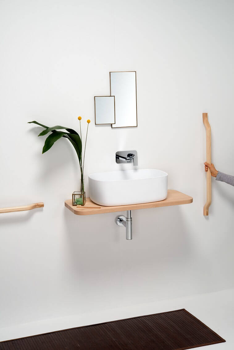 white wash basin on a wood stand,contemporary bathroom accessories,wooden bathroom towel bar,designer bathroom accessories,wood in bathroom ideas,