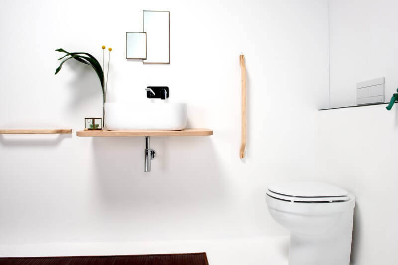 wooden bathroom towel bar,designer bathroom accessories,white wash basin on a wood stand,contemporary bathroom accessories,wood in bathroom ideas,