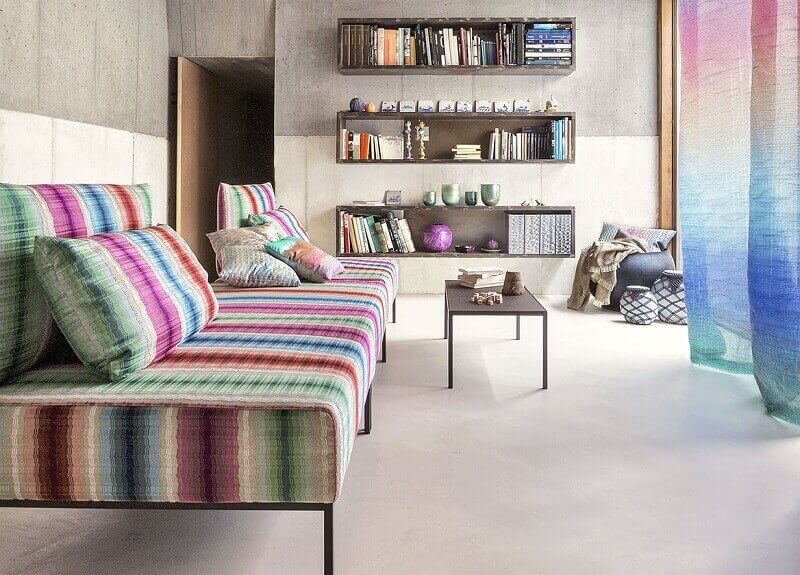 weekend interior design ideas,colorful sofa ideas,shelves in living room,vibrant color palette,decorative curtains,