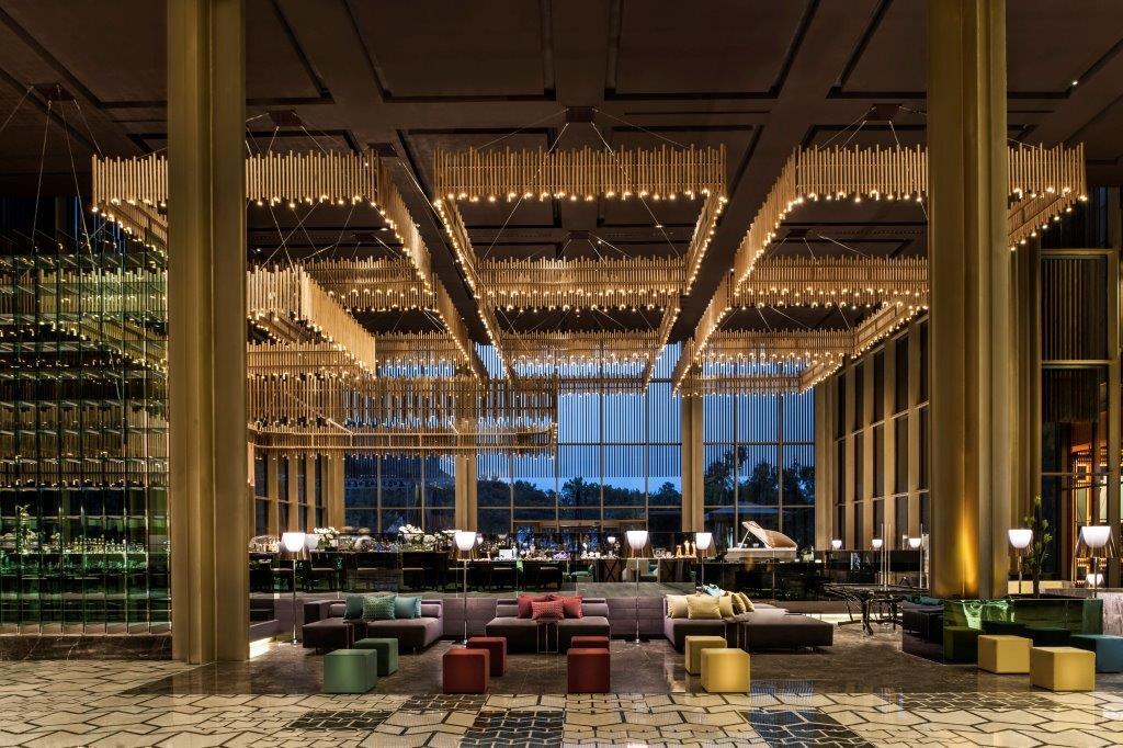 luxury lighting in hotel lobby interior design,restaurant design concepts turkey,geo id designs,yellow green red chairs restaurant,maxx royal kemer hotel antalya,