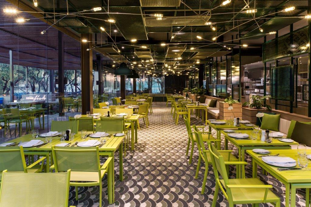 yellow green chairs restaurant,top luxury beach resorts in turkey,restaurant design concepts turkey,restaurant designers inspired by four elements,geo id designs,
