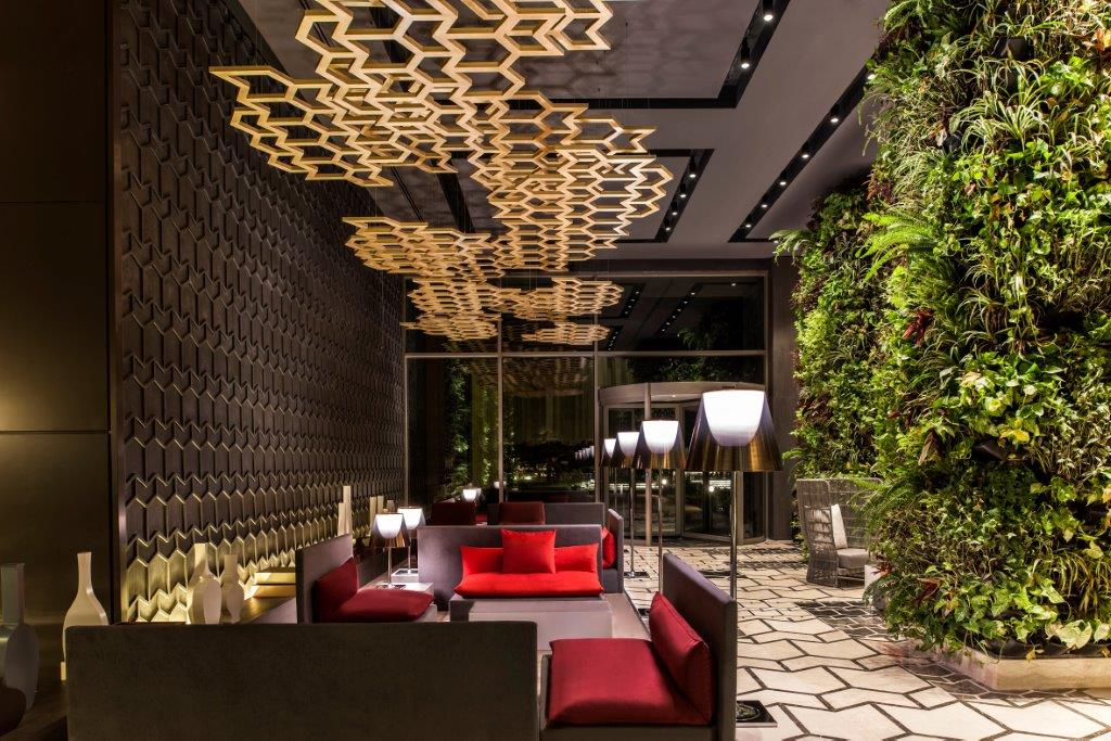 vertical gardens in hospitality design,luxury restaurant interior design,red and brown seating in restaurant,Maxx Royal Kemer Resort design,best boutique beach resorts turkey,