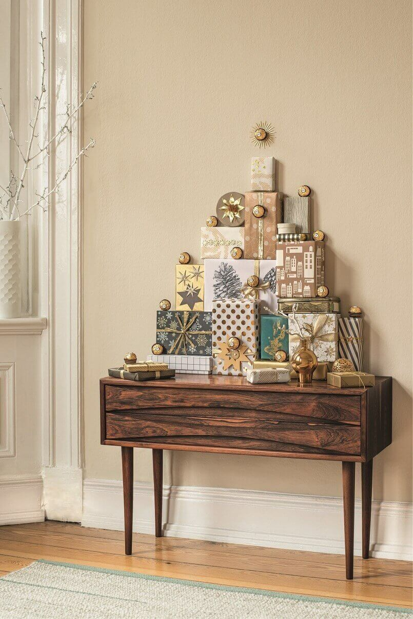 holiday gifts as decorations,Christmas tree made of gift boxes,how designers decorate for Christmas,holiday lobby decorations,entrance hall holidays,