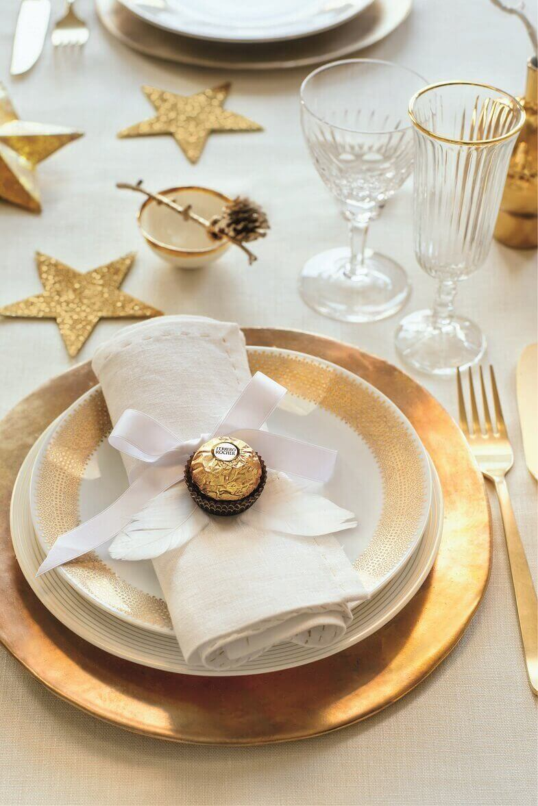 gold star table centerpiece,gold white luxury holiday decor,golden dinner plates,designer napkin folding ideas for Christmas,gold angel napkins decorative,