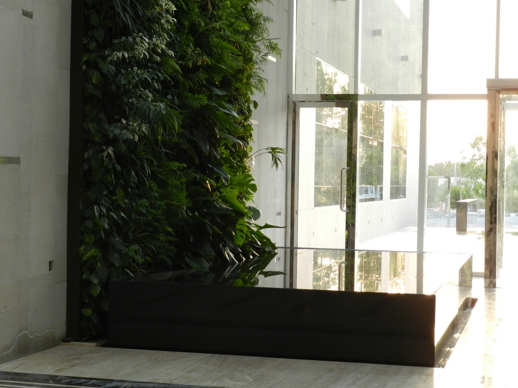 vertical garden in the lobby design,vertical garden above pool area,greenery and water in interior design,greenery in lobby ideas,golf club design ideas,