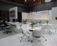 workplace 3.0 salone del mobile,black and white office decorating ideas,white meeting room table,white conference room chairs,innovative office design solutions,
